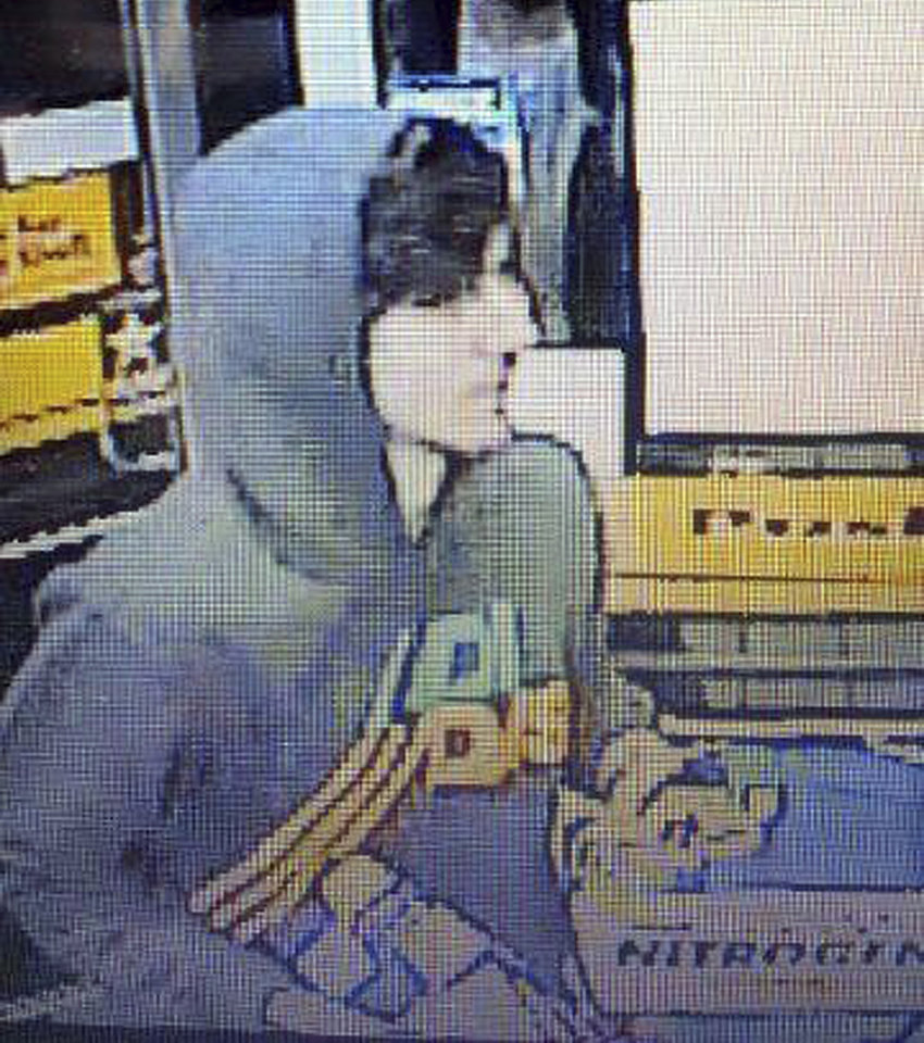 This surveillance photo released via Twitter Friday, April 19, 2013 by the Boston Police Department shows a suspect entering a convenience store that police are pursuing in Watertown, Mass.  Police say he is one of two suspects in the fatal shooting of an MIT police officer and tied to the Boston Marathon bombing. (AP Photo/Boston Police Department)