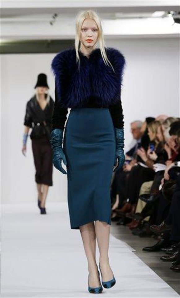 Photo - Fashion from the Oscar de la Renta Fall 2013 show is modeled during Fashion Week in New York, Tuesday, Feb. 12, 2013.  (AP Photo/Kathy Willens)