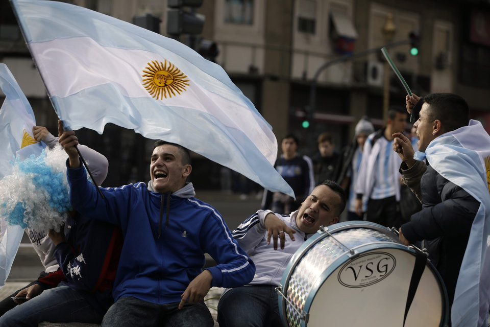 Photo - Argentina soccer fans wave an Argentine flag prior to the final Brazil World Cup game between Argentina and Germany in Buenos Aires, Argentina, Sunday, July 13, 2014. (AP Photo/Jorge Saenz)