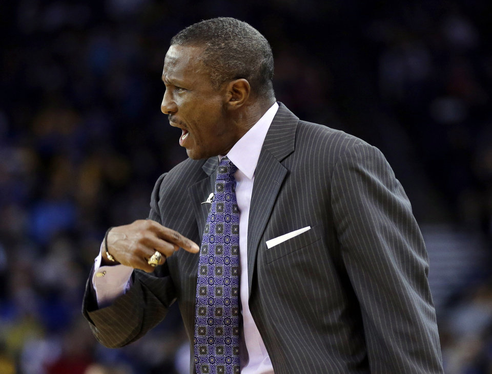 Photo - Toronto Raptors head coach Dwane Casey instructs his team against the Golden State Warriors during the first half of an NBA basketball game on Tuesday, Dec. 3, 2013, in Oakland, Calif. (AP Photo/Marcio Jose Sanchez)