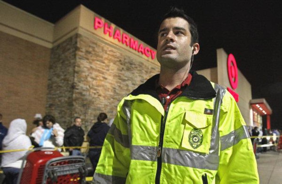 Hunter Witt, who leads the asset protection team at Target in Moore, supervises the crowd outside. <strong>STEVE SISNEY - THE OKLAHOMAN</strong>