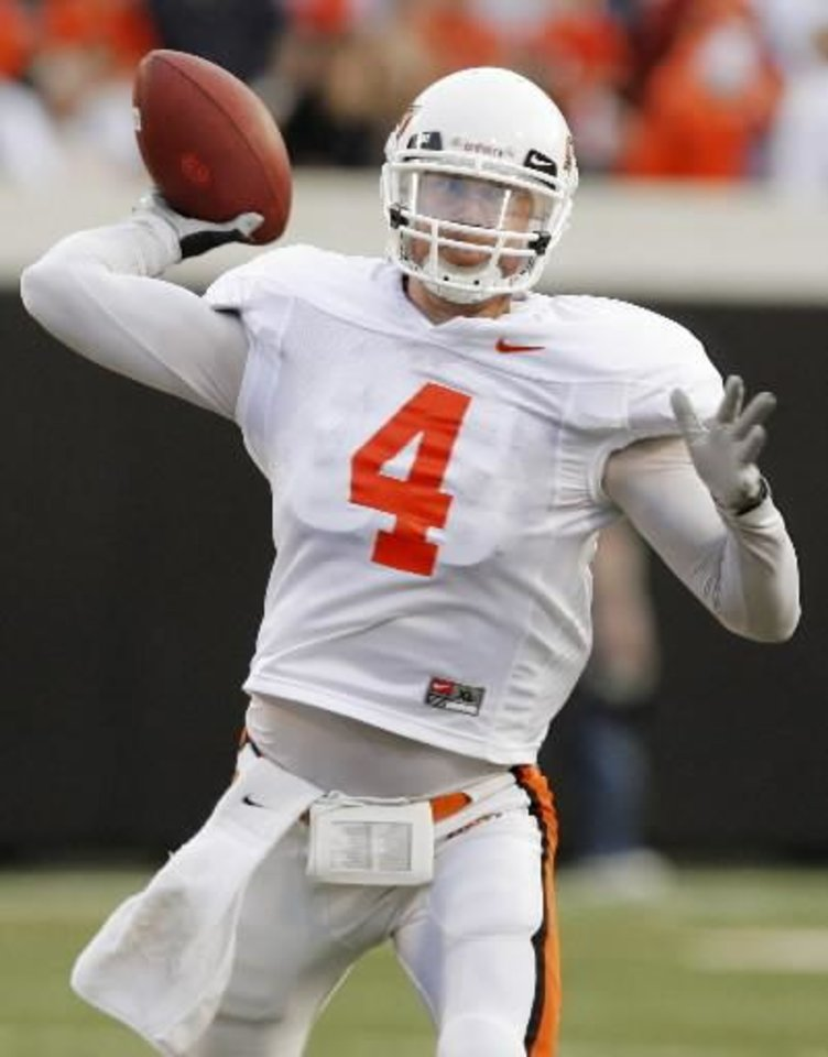 Photo - OSU's Brandon Weeden (4) passes the ball during the Orange and White spring football game for the Oklahoma State University Cowboys at Boone Pickens Stadium in Stillwater, Okla., Saturday, April 18, 2009. The Orange team won, 20-15. Photo by Nate Billings
