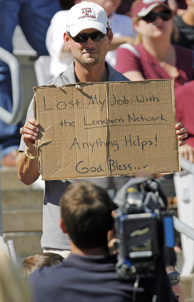 A Texas A&M fan holds a sign for a cameraman that references the controversy over the University of Texas' Longhorn Network during the OSU-A&M game on Saturday. Photo by Nate Billings, The Oklahoman