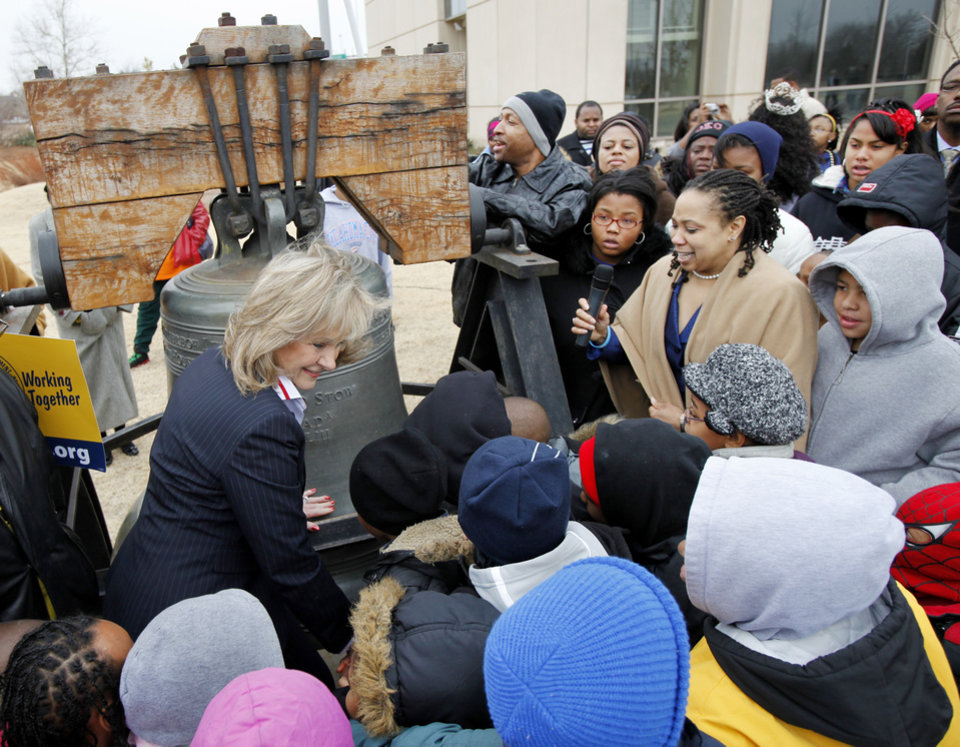 Photo - Gov. Mary Fallin rings a Liberty Bell, replica outside the Oklahoma History Center during a Martin Luther King Day ceremony in Oklahoma City, January 17 , 2011. Photo by Steve Gooch, The Oklahoman