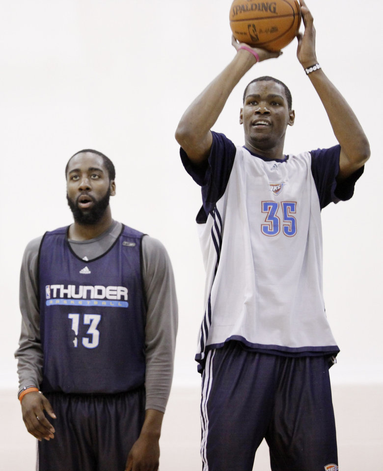 THE GYM RAT : A sometimes forgotten part of Kevin Durant\'s ascension as an NBA superstar is the hard work behind his talents. The story of him taking a pillow to his neighborhood rec center so he could eat, sleep and play basketball may someday become the stuff of legend, but only because Durant, shown here at a Thunder practice with teammate James Harden, continues that approach to this day.