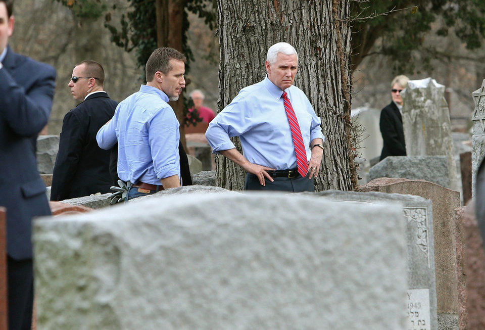 Photo - Missouri Gov. Eric Greitens and Vice President Mike Pence view some of the damage done at the Chesed Shel Emeth Cemetery in University City, Mo., on Wednesday, Feb. 22, 2017. Over 150 headstones had been overturned by vandals. (J.B. Forbes /St. Louis Post-Dispatch via AP)