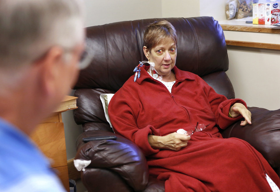 Louise Pond talks with her husband, Allen, about her successful liver transplant in her room at OU Medical Center. She is a middle school principal in Sand Springs. <strong>Jim Beckel - THE OKLAHOMAN</strong>
