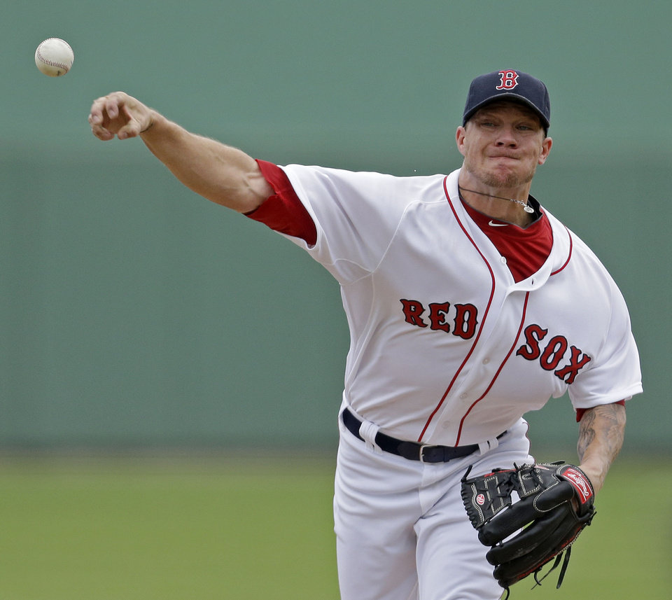 Photo - Boston Red Sox starting pitcher Jake Peavy pitches during the first inning of an exhibition baseball game against the Minnesota Twins in Fort Myers, Fla., Saturday, March 29, 2014. (AP Photo/Gerald Herbert)
