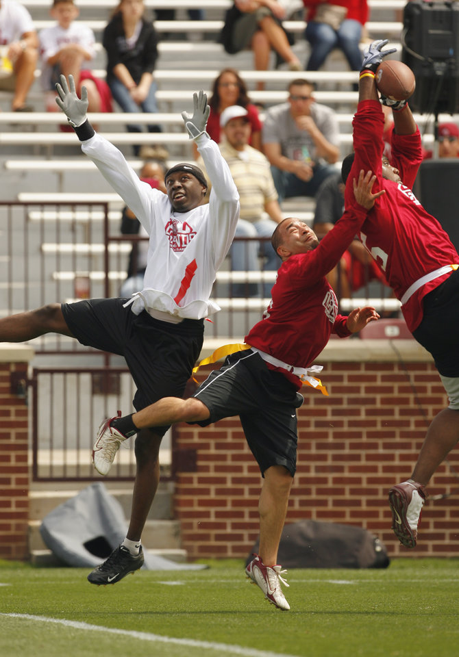 Photo - Football alums play flag football before the University of Oklahoma Sooner's (OU) Spring Football game at Gaylord Family-Oklahoma Memorial Stadium on Saturday, April 16, 2011, in Norman, Okla.  