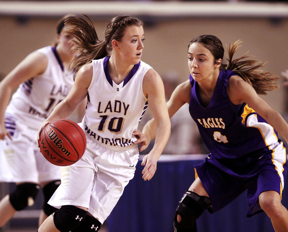 Photo - Okarche senior Laci Friesen moves the ball past Red Oak's Paige Campagna in the  Class B girls high school basketball championship game in the Jim Norick Arena at State Fair Park on  Saturday, March 8, 2014.   Okarche defeated Red Oak, 66-41. Photo by Jim Beckel, The Oklahoman