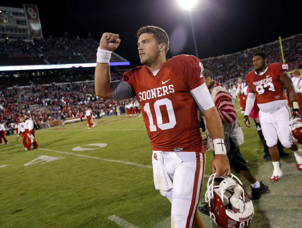 Photo - Oklahoma's Blake Bell (10) celebrates as he walks off the field after a college football game between the University of Oklahoma Sooners (OU) and the TCU Horned Frogs at Gaylord Family-Oklahoma Memorial Stadium in Norman, Okla., on Saturday, Oct. 5, 2013. Oklahoma won 20-17. Photo by Bryan Terry, The Oklahoman