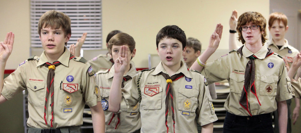 Grayson Bryant, Tucker Johnson, Noah Patton, Sebastian Matthews, Jimmy Griffin and Conner Andersen say an oath Monday during Troop 1's meeting at St. Mary's Episcopal Church. Boy Scout Troop 1 will celebrate its 100th year of continuous charter this year. Photo By David McDaniel, The Oklahoman