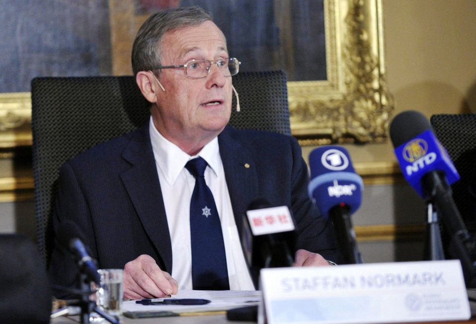 Staffan Normark, a member of the Swedish Academy of Sciences presents the 2012 Nobel Prize laureates in Physics, during a press conference at the Royal Swedish Academy of Sciences, in Stockholm, Sweden, Tuesday, Oct. 9, 2012. A French-American duo shared the 2012 Nobel Prize in physics Tuesday for inventing methods to observe the bizarre properties of the quantum world, research that has led to the construction of extremely precise clocks and helped scientists take the first steps toward building superfast computers. Serge Haroche of France and American David Wineland opened the door to new experiments in quantum physics by showing how to observe individual quantum particles without destroying them, the Royal Swedish Academy of Sciences said. (AP Photo/Bertil Enevag Ericson /Scanpix) SWEDEN OUT