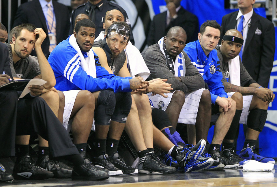 Photo -   Players on the Orlando Magic bench, from left, Ryan Anderson, Earl Clark, Hedo Turkoglu, Jameer Nelson, Jason Richardson, J.J. Redick and Quentin Richardson, watch during the final minutes of Game 3 of an NBA first-round playoff basketball series against the Indiana Pacers, Wednesday, May 2, 2012, in Orlando, Fla. Indiana won 97-74. (AP Photo/John Raoux)