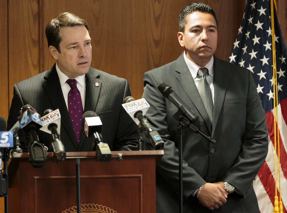 Photo - United States Attorney Mark A. Yancey, left, and FBI Assistant Special Agent in Charge Raul Bujanda speak during a press conference at the  U.S. Attorney's Office in Oklahoma City, Okla. on Monday, Aug. 14, 2017. about the arrest of Jerry Drake Varnell, 23, of Sayre, for a plan to blow up a BancFirst building in located at 101 N. Broadway in downtown Oklahoma City, Okla. Varnell, was arrested Saturday with what authorities says is a foiled plot to blow up the bank building with a truck filled with fake explosives. Photo by Chris Landsberger, The Oklahoman