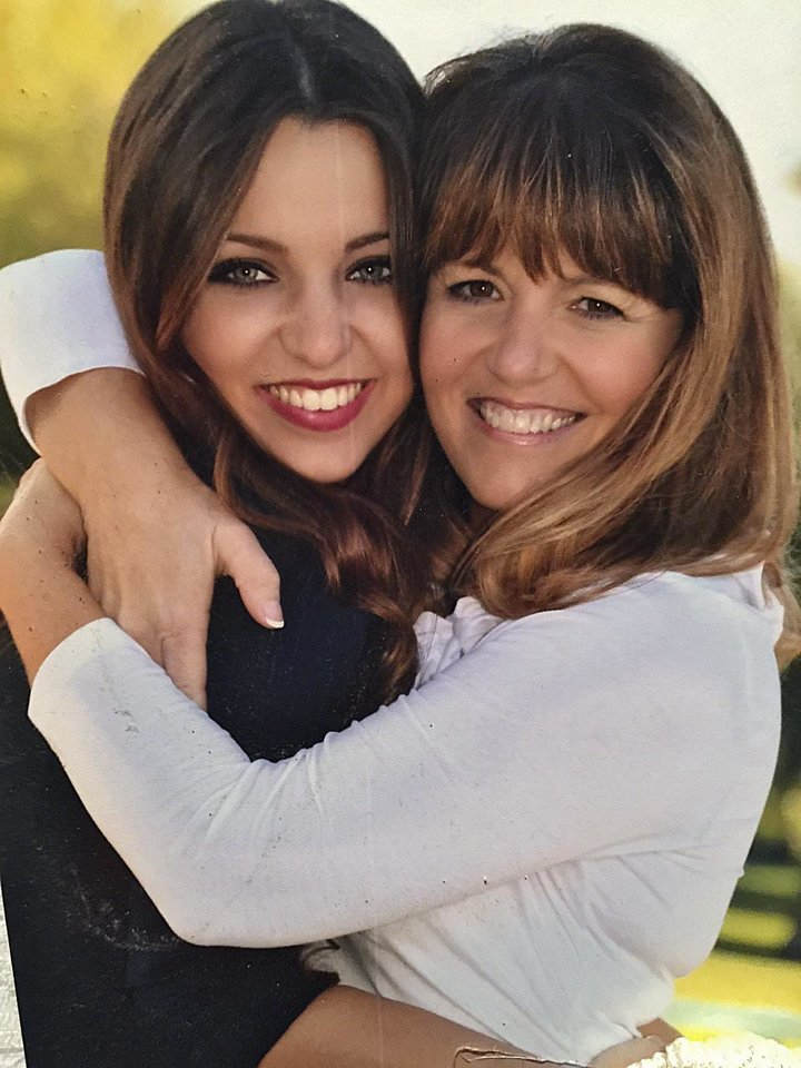 Photo - Amanda and Mary Cardinal pose for a photo. Amanda is a freshman at Oklahoma State University. Her mom, Mary, was injured by the crash at OSU's homecoming parade. [Photo submitted]