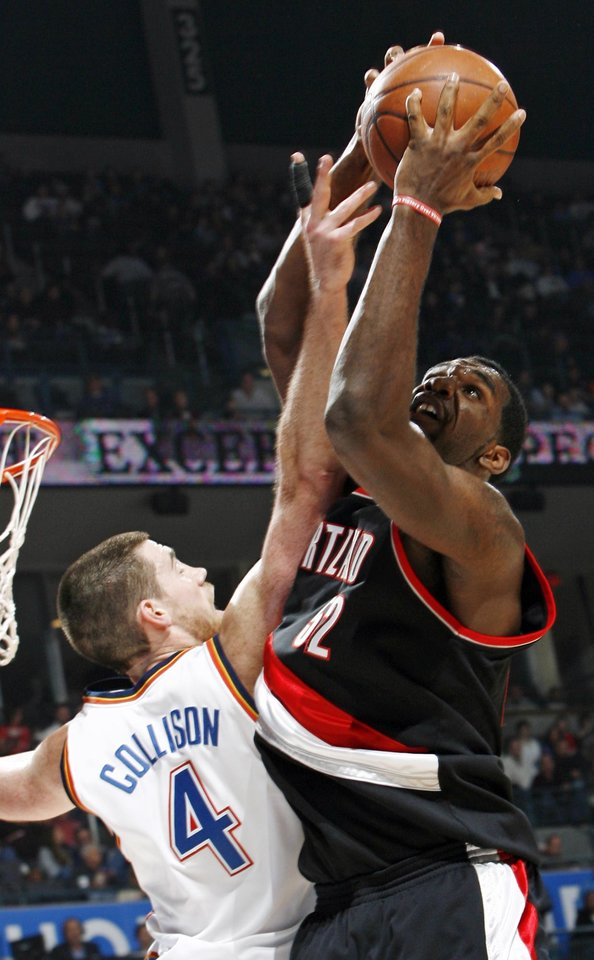 Portland's Greg Oden (52) grabs a rebound over Nick Collison (4) of Oklahoma City during the NBA basketball game between the Oklahoma City Thunder and the Portland Trail Blazers at the Ford Center in Oklahoma City, Friday, February 6, 2009. BY NATE BILLINGS, THE OKLAHOMAN