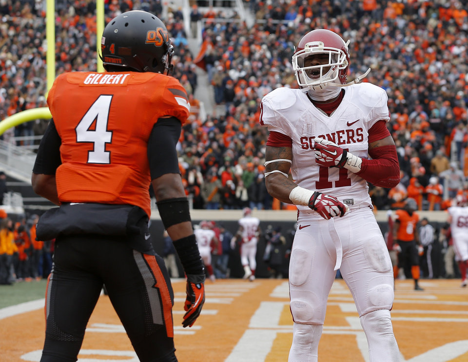 Oklahoma's Lacoltan Bester (11) celebrates in front of Oklahoma State's Justin Gilbert (4) after OU scored a touchdown in the final minute of the Bedlam college football game between the Oklahoma State University Cowboys (OSU) and the University of Oklahoma Sooners (OU) at Boone Pickens Stadium in Stillwater, Okla., Saturday, Dec. 7, 2013. Oklahoma won 33-24. Photo by Bryan Terry, The Oklahoman
