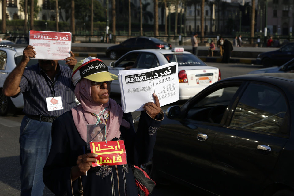 Photo - Egyptian activists encourage passersbys to sign a petition by Tamarod, Arabic for