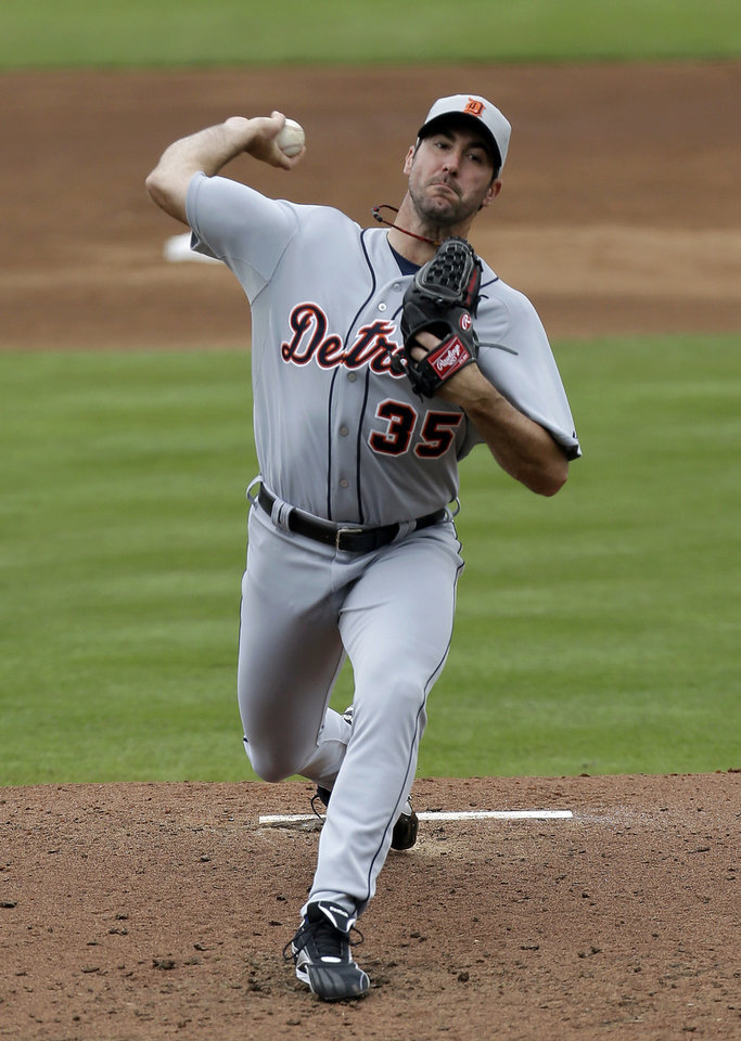 Photo - Detroit Tigers pitcher Justin Verlander throws against the New York Mets during the third inning of an exhibition spring training baseball game, Friday, March 1, 2013, in Port St. Lucie, Fla. (AP Photo/Julio Cortez)