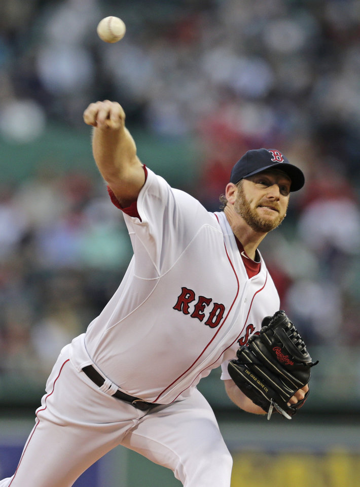 Photo - Boston Red Sox starting pitcher Ryan Dempster delivers to the Cleveland Indians during the first inning of a baseball game at Fenway Park in Boston, Thursday, May 23, 2013. (AP Photo/Charles Krupa)