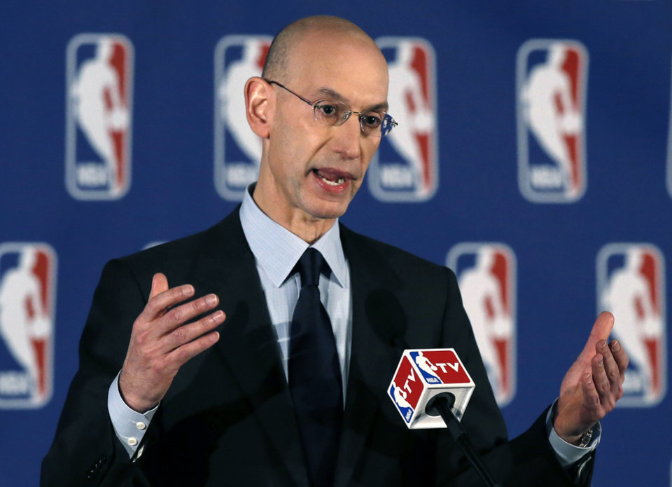 Photo -  NBA Commissioner Adam Silver addresses a news conference in New York, Tuesday, April 29, 2014.  Silver announced that Los Angeles Clippers owner Donald Sterling has been banned for life by the league in response to racist comments the league says he made in a recorded conversation.(AP Photo/Kathy Willens)