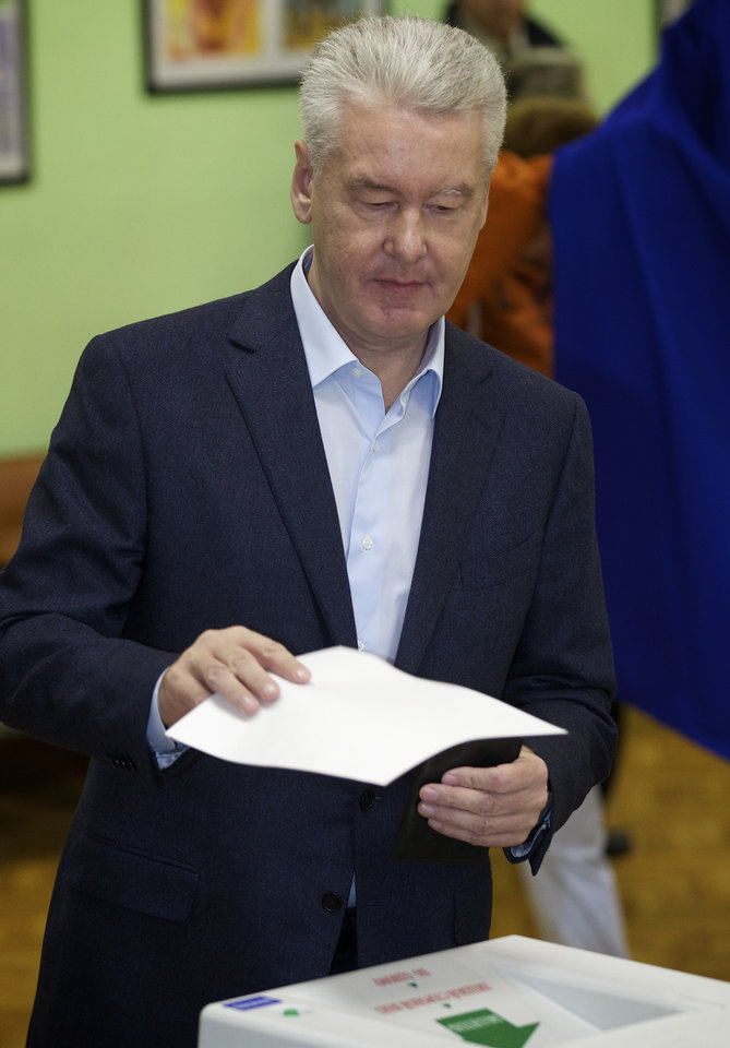 Photo - Moscow's acting mayor Sergei Sobyanin casts his ballot at a polling station in Moscow, Russia, Sunday, Sept. 8, 2013. Moscow is holding its first mayoral election in a decade. Although an incumbent backed by President Vladimir Putin is expected to win Sunday's election handily, the candidacy of charismatic opposition leader Alexei Navalny is changing Russian politics in ways that could pose a risk for the Kremlin in the months and years ahead. (AP Photo/Alexander Zemlianichenko)