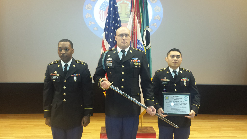 Photo -  Matt Meloni receives a sword identifying him as a Distinguished Leader awardee at Sergeants school. [Photo provided]