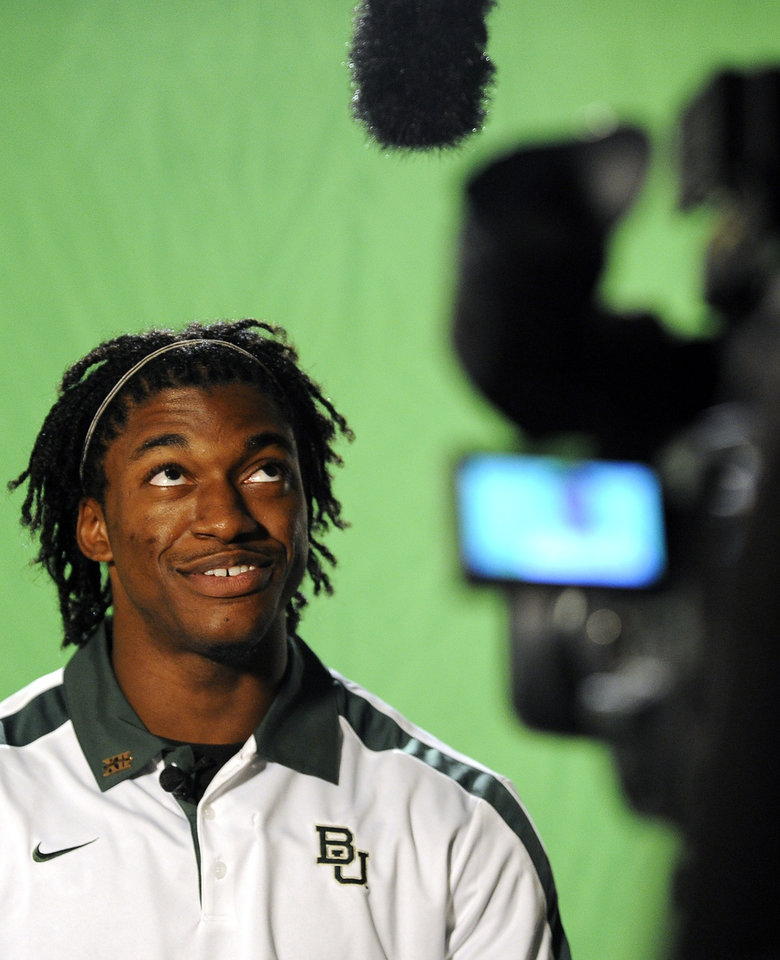 Baylor quarterback Robert Griffin III jokes around during NCAA college football Big 12 Media Days, Monday, July 25, 2011, in Dallas. (AP Photo/Matt Strasen)