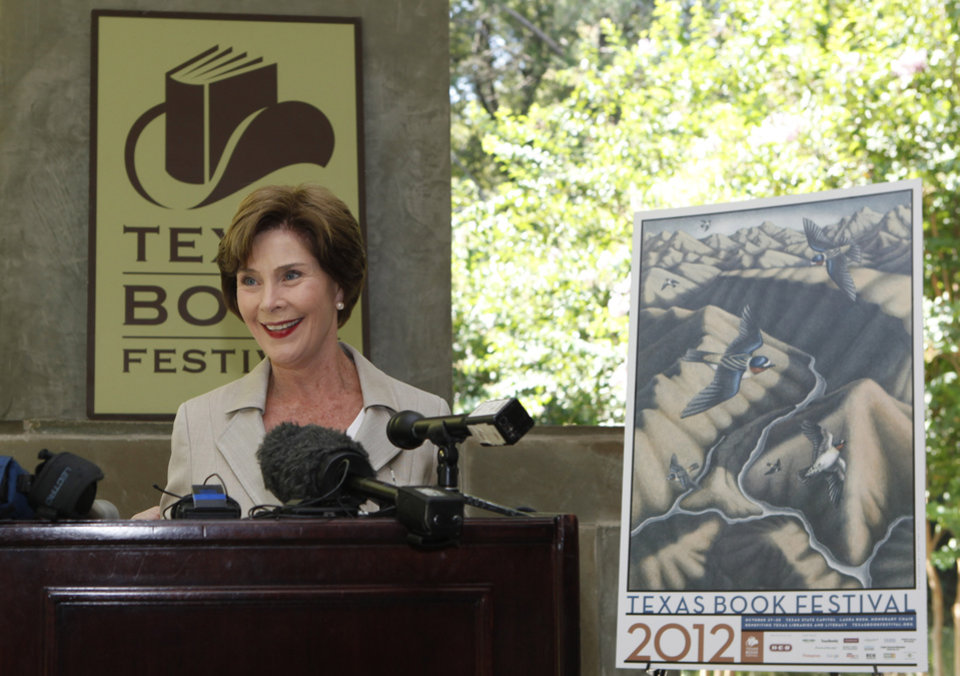 Photo -   Former first lady Laura Bush speaks at a announcement of the lineup for the 2012 Texas Book festival Wednesday, Sept. 12, 2012, at her home in the Preston Hollow section of Dallas. Bush, who founded the festival when she was first lady of Texas, also unveiled this year's book festival poster for the annual event in Austin. (AP Photo/LM Otero)