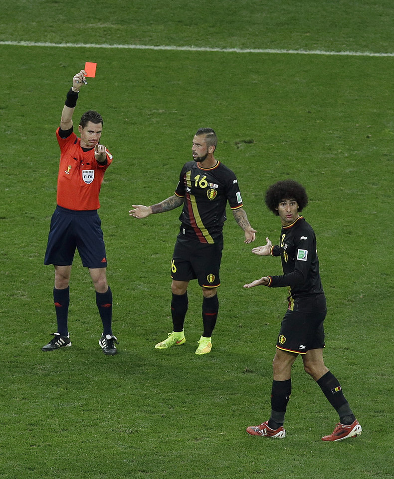 Photo - Belgium's Steven Defour (16) is given a red card after fouling South Korea's Kim Shin-wook (not seen), as team mate Marouane Fellaini tries to argue during the group H World Cup soccer match between South Korea and Belgium at the Itaquerao Stadium in Sao Paulo, Brazil, Thursday, June 26, 2014. (AP Photo/Andrew Medichini)