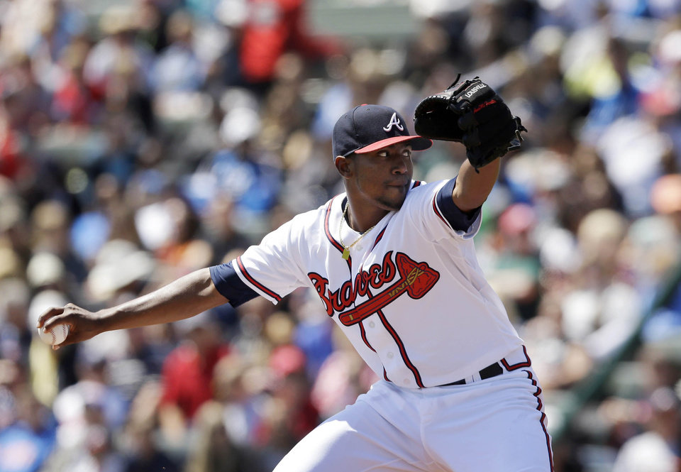 Photo - Atlanta Braves pitcher Julio Teheran throws during the first inning of a spring exhibition baseball game against the Miami Marlins in Kissimmee, Fla., Wednesday, March 26, 2014. (AP Photo/Carlos Osorio)