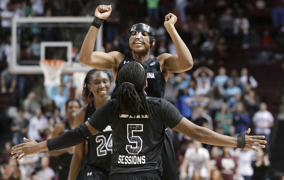 Photo - South Carolina guard Tiffany Mitchell (25) is congratulated by teammate Khadijah Sessions (5) after she hit a 3-pointer to tie the game with 5.1 seconds left in the second half of an NCAA women's basketball game against Texas A&M, Thursday, Jan. 16, 2014, in College Station, Texas. (AP Photo/Patric Schneider)