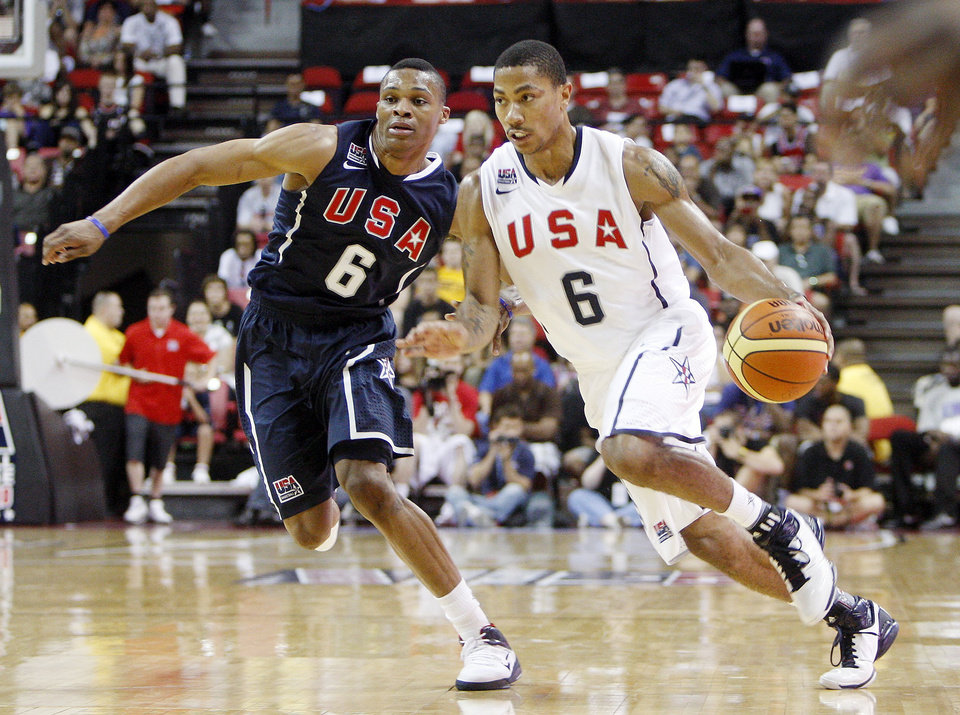 Russell Westbrook, left, covers Derrick Rose, right, during a USA Basketball men's national team exhibition game, Saturday, July 24, 2010 in Las Vegas. (AP Photo/Isaac Brekken) ORG XMIT: NVIB104