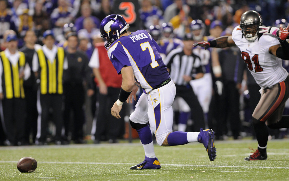 Photo -   Minnesota Vikings quarterback Christian Ponder (7) fumbles the ball in front of Tampa Bay Buccaneers defensive end Da'Quan Bowers, right, during the second half of an NFL football game Thursday, Oct. 25, 2012, in Minneapolis. Ponder recovered the ball. (AP Photo/Jim Mone)