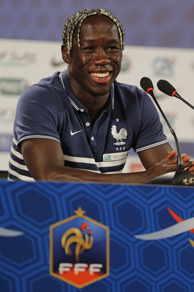 Photo - France's player Bakary Sagna answers questions during a press conference at the Teatro Pedro II in Ribeirao Preto, Brazil, Friday, June 27, 2014. France will face Nigeria on Monday in the round of 16 at the World Cup. (AP Photo/David Vincent)