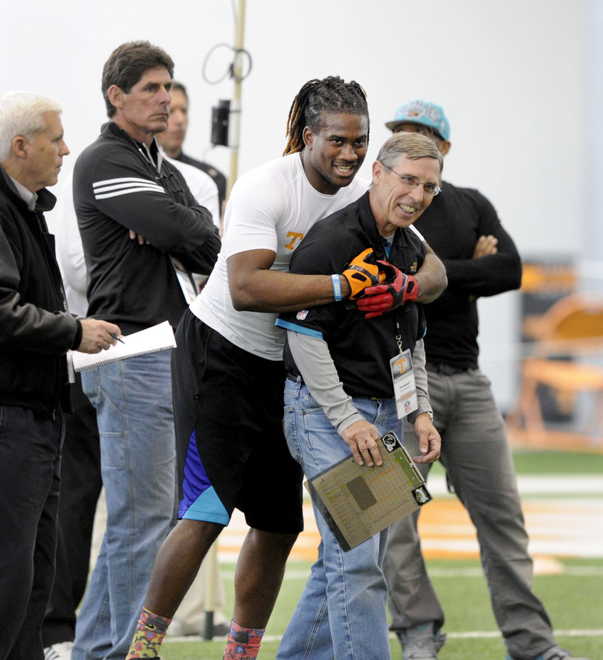 Photo - Wide receiver Cordarrelle Patterson grabs Jacksonville Jaguars scout Tim Mingey during pro day at tge University of Tennessee, Wednesday, March 20, 2013, in Knoxville, Tenn.  (AP Photo/The Knoxville News Sentinel, Michael Patrick)