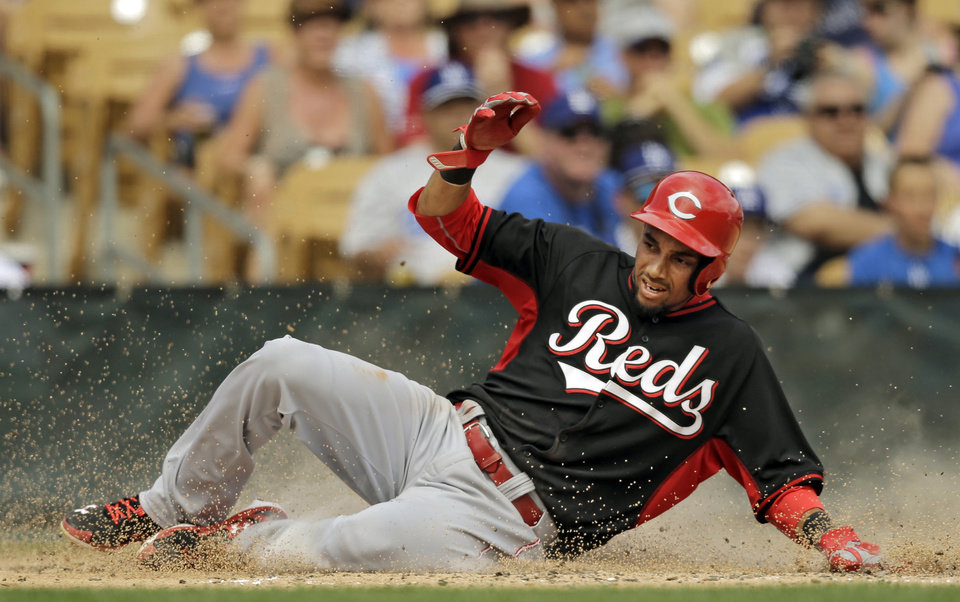 Photo - Cincinnati Reds' Billy Hamilton scores on a single hit by Jay Bruce in the third inning of a spring exhibition baseball game against the Los Angeles Dodgers, Thursday, March 13, 2014, in Glendale, Ariz. (AP Photo/Mark Duncan)