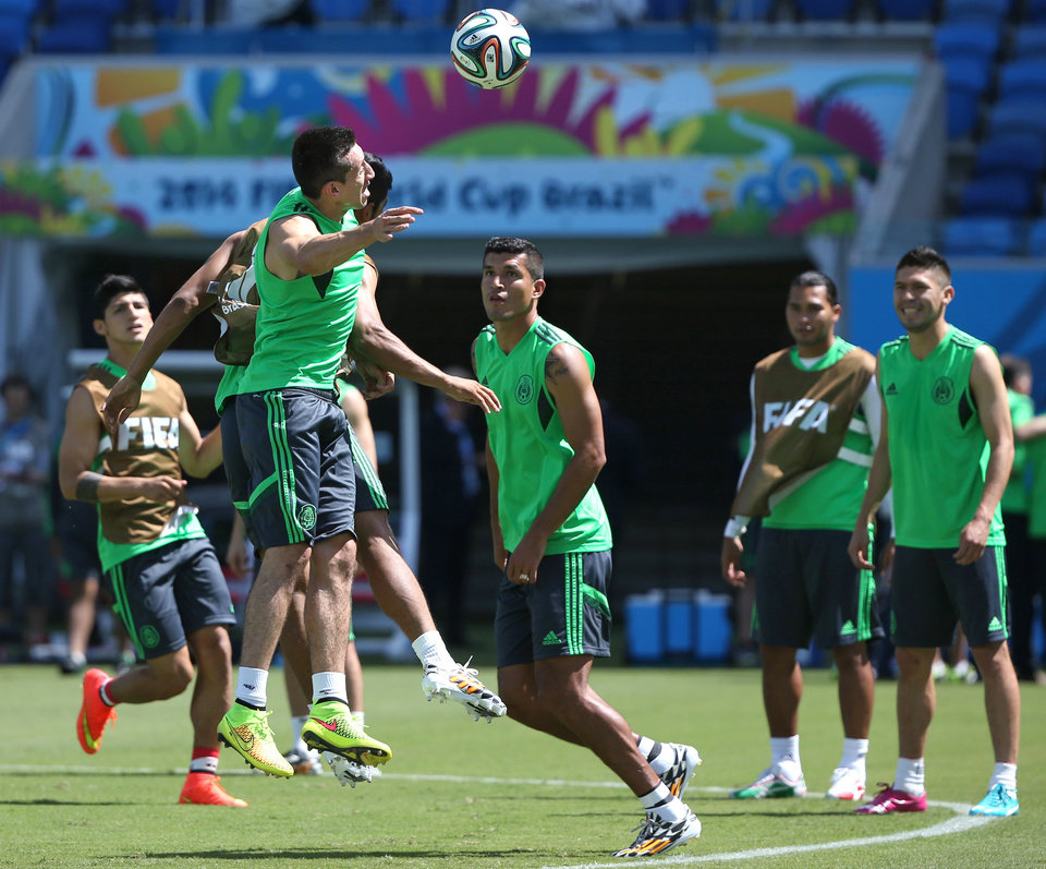 Photo - Mexico's soccer players train for the World Cup at the Arena das Dunas stadium in Natal, Brazil, Thursday, June 12, 2014. (AP Photo/Sergei Grits)