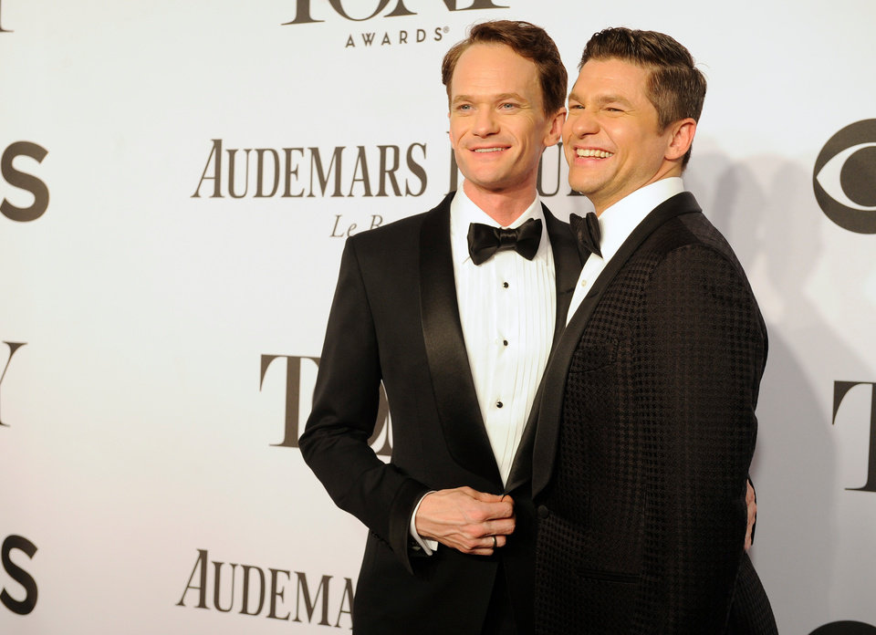 Photo - Neil Patrick Harris, left, and David Burtka arrive at the 68th annual Tony Awards at Radio City Music Hall on Sunday, June 8, 2014, in New York. (Photo by Charles Sykes/Invision/AP)