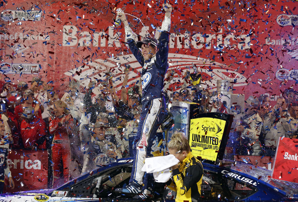 Photo - Brad Keselowski celebrates in Victory Lane after winning the NASCAR Sprint Cup Series auto race at Charlotte Motor Speedway in Concord, N.C., Saturday, Oct. 12, 2013. (AP Photo/Gerry Broome)