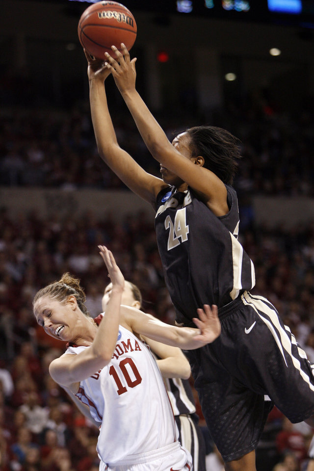 Photo - Lakisha Freeman shoots over Carlee Roethlisberger in the first half as the University of Oklahoma (OU) plays Purdue in the NCAA women's basketball regional tournament finals at the Ford Center in Oklahoma City, Okla., on Tuesday, March 31, 2009.  Photo by Steve Sisney, The Oklahoman