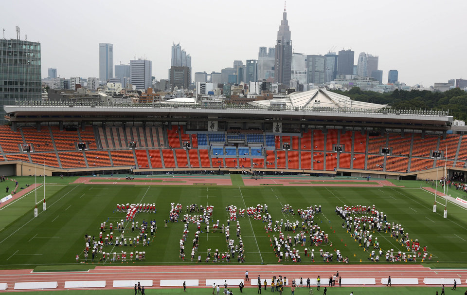 """Photo - The volunteers form the words """"Tokyo 2020"""