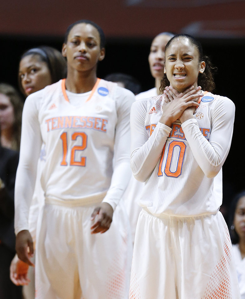 Photo - Tennessee's Meighan Simmons (10) and Bashaara Graves (12) watch the action in the second half of an NCAA women's college basketball second-round tournament game against St. John's Monday, March 24, 2014, in Knoxville, Tenn. (AP Photo/John Bazemore)