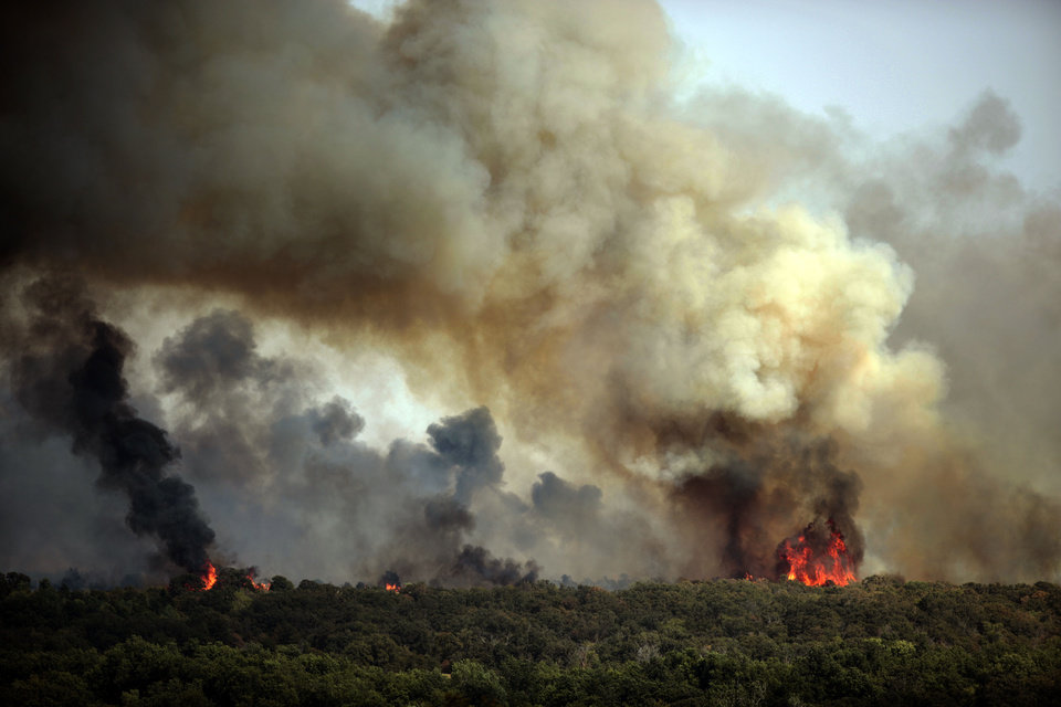A wildfire burns in Luther, Okla.,  Friday, Aug. 3, 2012. <strong>SARAH PHIPPS - THE OKLAHOMAN</strong>