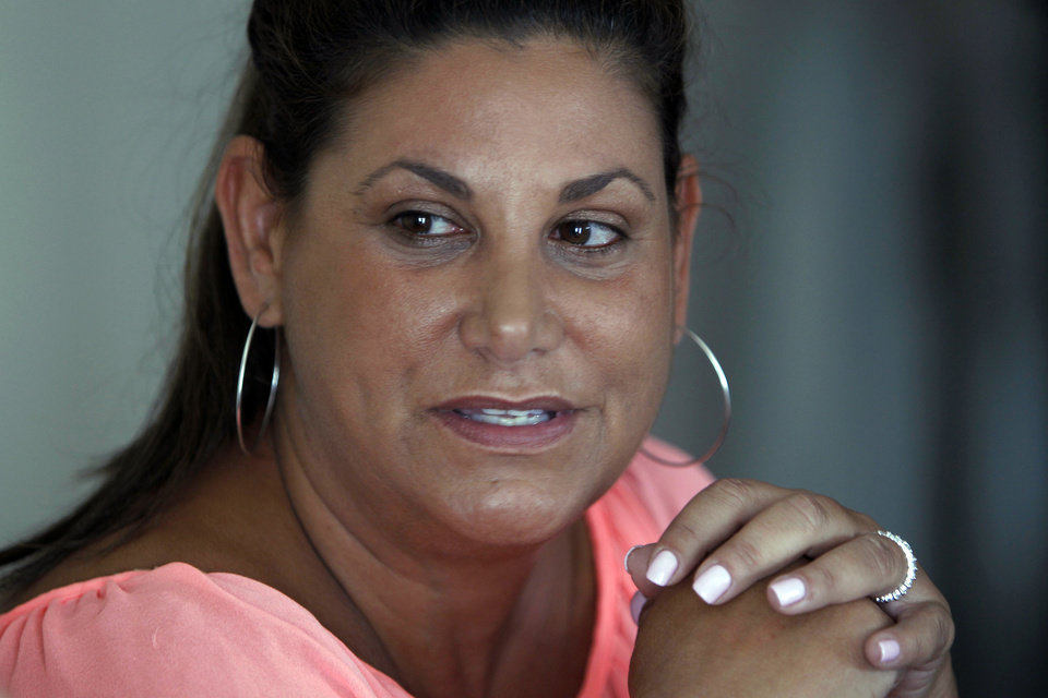 Photo - Laurie Navon, girlfriend of former NFL football quarterback Jim McMahon, speaks during a news conference Tuesday, June 17, 2014 in Chicago.  McMahon spoke of his ongoing battle with dementia that he believe is related to his years of hits he took while playing in the league. McMahon is part of a federal lawsuit filed in San Francisco accusing teams of illegally dispensing powerful narcotics and other drugs to keep players on the field without regard for their long-term health. He led the Chicago Bears to victory in the 1985 Super Bowl. (AP Photo/Stacy Thacker)