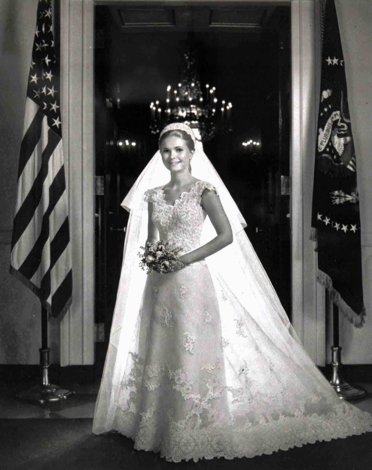 Photo - FILE-  This June 12, 1971 file photo courtesy of the White House shows Tricia Nxion in her wedding gown at the White House in Washington.  The White House wedding of Tricia Nixon in 1971 _ and the Priscilla Kidder gown she chose for it _ became the fantasy of young women across America, says vintage fashion expert Shareen Mitchell, whose TV series