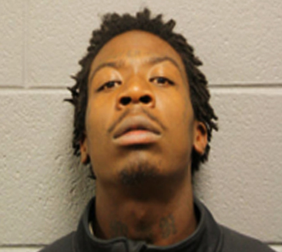 Photo - This booking photo provided Sept. 24, 2013 by the Chicago Police Department shows 21-year-old Bryon Champ. Champ was one of four men charged in relation to a shooting that injured 13 people including a 3-year-old boy at Cornell Square Park on Chicago's southwest side on Thursday, Sept. 19, 2013. (AP Photo/Chicago Police Department)