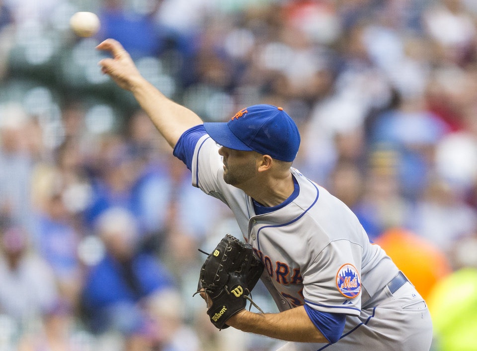 Photo - New York Mets' Dillon Gee pitches to a Milwaukee Brewers' batter during the first inning of a baseball game Thursday, July 24, 2014, in Milwaukee. (AP Photo/Tom Lynn)
