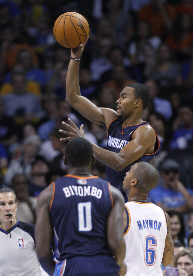 Photo -   Charlotte Bobcats guard Ramon Sessions shoots in front of center Bismack Biyombo (0) and Oklahoma City Thunder's Eric Maynor (6) in the second quarter of a preseason NBA basketball game in Oklahoma City, Tuesday, Oct. 16, 2012. (AP Photo/Sue Ogrocki)